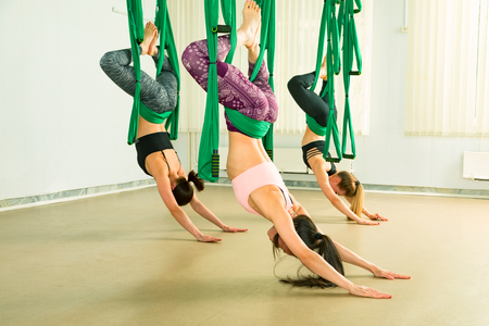 Young woman performing aerial yoga exercise Reklamní fotografie - 101896490