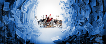 Santa Claus and his deer in Cristmas holiday Reklamní fotografie