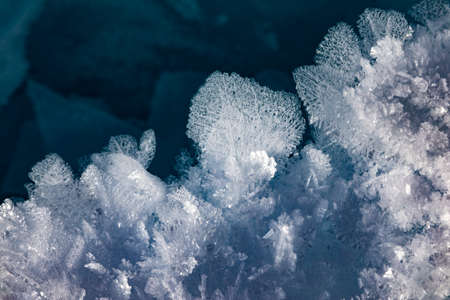Huge beautiful snowflakes on the ice of Lake Baikal