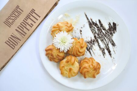 Brewing cakes with flower. Coffee desserts. Delicious dessert with coffee.