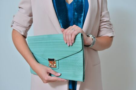 Fashionable turquoise stylish bag in a hand Imagens