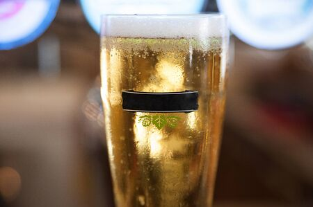 Glass of cold beer, with foam and a place for an inscription. Glass of beer.