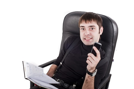 buisiness: buisiness man in chair with phone