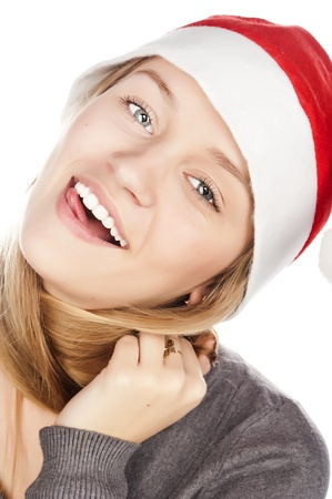 cheerful girl with a white-toothed smile in Santa Claus hat, close-up portrait, snow-white smile photo