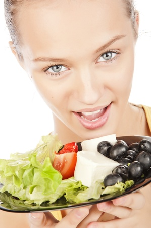 closeup portrait of attractive girl with a plate of vegetable salad photo