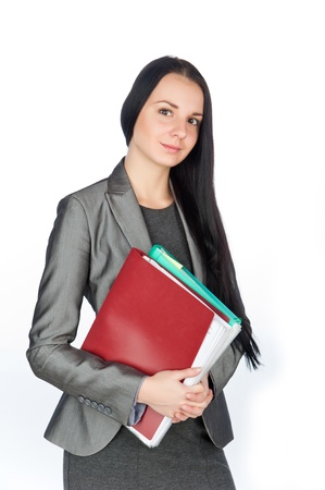 young beautiful businesswoman holding folders,isolated on white Stock Photo - 11430838