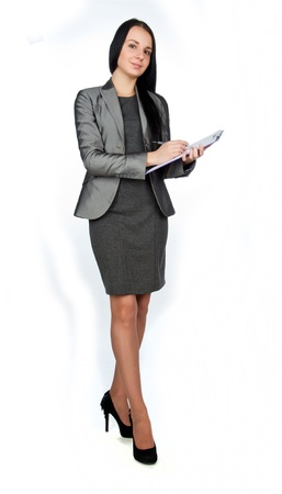 'young things': young beautiful businesswoman holding a tablet,isolated on white