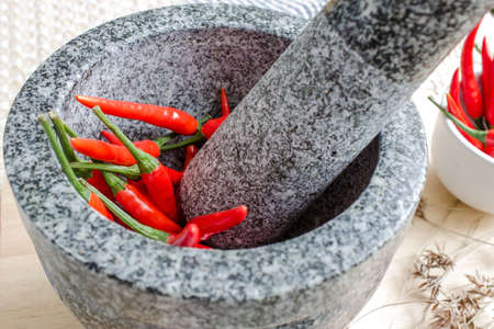 Red pepper in mortar photo