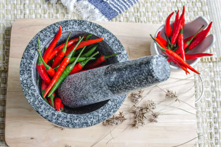 red chilli pepper plant: Red and green pepper in mortar