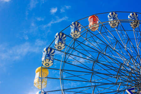 ferry wheel under bright blue sky photo