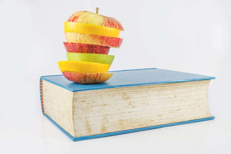 Book and an fruits on a white background  Stock Photo