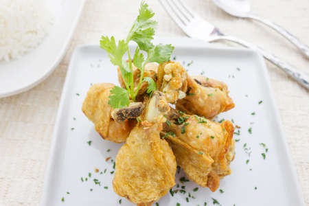 Chicken wings Fried in white dish on table photo