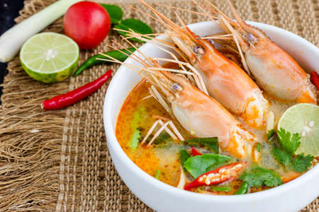 Tom yam kung or Tom yum, Tom yam is a spicy clear soup typical in Thailand and No.1 Thai Dish Cuisine.