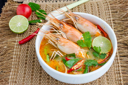 Tom yam kung or Tom yum, Tom yam is a spicy clear soup typical in Thailand and No.1 Thai Dish Cuisine. Stock Photo - 22364474