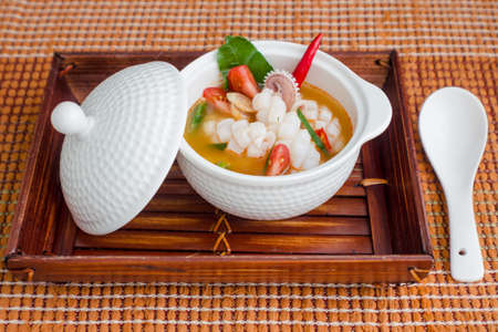squid spicy lemongrass soup, tom yum, thaifood photo