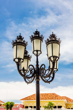 Vintage Outdoor Lamp with blue sky, recorded in Thailand on The Venezia Hua Hin. photo