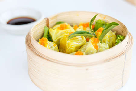 shumai Chinese dumpling dim sum yumcha made from shrimp, fish and chicken with salmon egg photo