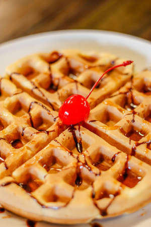 Sweet and delicious waffles with cherry