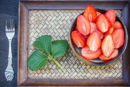 ripe red strawberries in a ceramic bowl photo