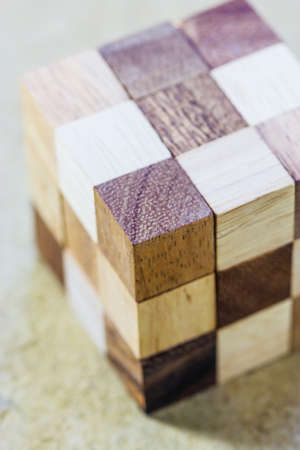 teaser: Cube puzzle in the form of wooden blocks Stock Photo