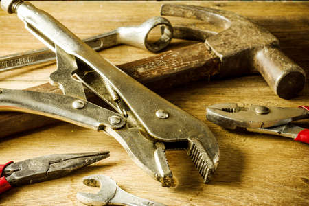 set of hand tools on a wooden panel photo