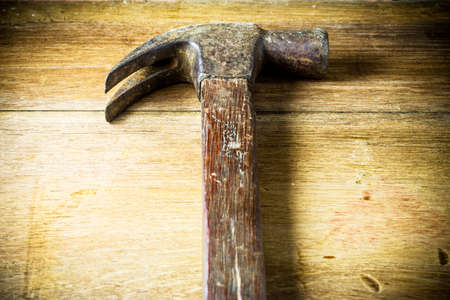 hammer head: Hammer head  on a wooden panel with space for text