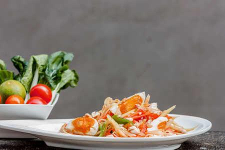 green papaya salad with salted egg thai food, Thai cuisine Stock Photo - 25788751