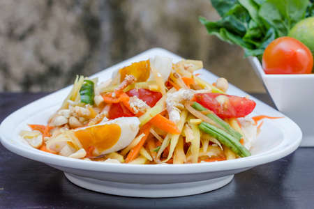 green papaya salad with salted egg thai food, Thai cuisine photo