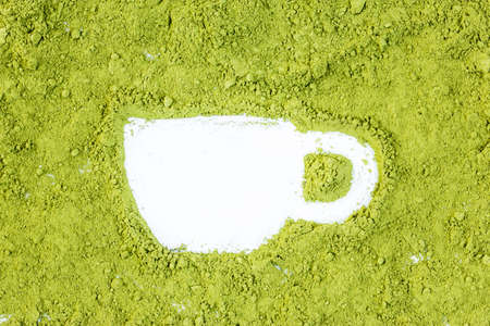 green drink powder: green powder forming cup shape surface close up isolated on white  Stock Photo