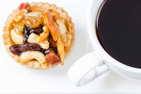 Black coffee and Fruit Tart  on wooden table photo