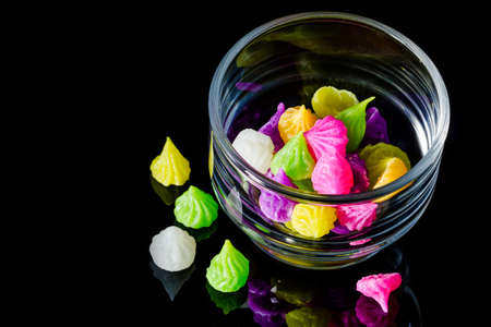 Colorful sweetness Thai style dessert in glass on black background  photo
