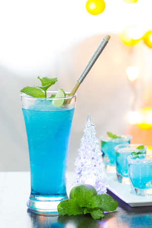 Cold Blue Hawaiian cocktail in a night party  photo