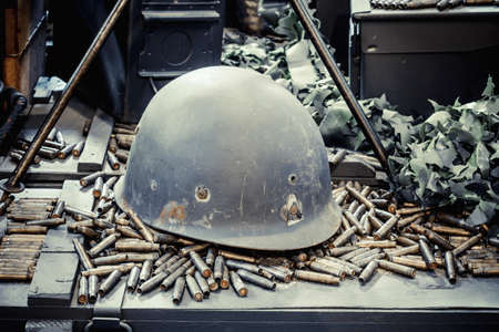 Old military helmet and bullets photo