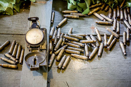 warheads: old army compass and bullets. still life Stock Photo