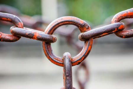Close up of a metal rusty chains link segment photo