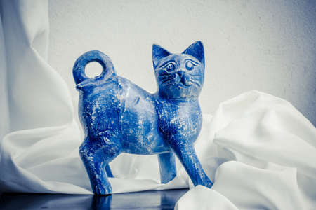 A handmade wooden sculpture of cat painted by hand  Still life  photo