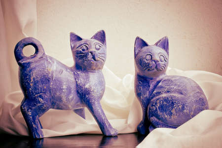 A handmade wooden sculpture of cats painted by hand  Still life  photo