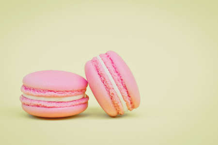 Sweet  french macaroons on retro-vintage background photo