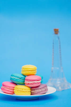Sweet and colourful french macaroons on retro-vintage background photo