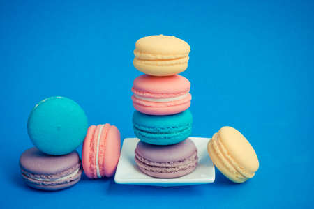 Sweet and colourful french macaroons on background photo