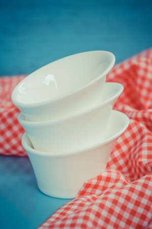 Different tableware on  table  white kitchen bowls photo