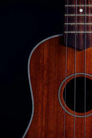 Ukulele hawaiian guitar over dark background  photo