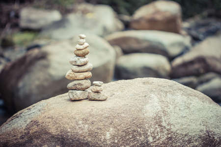 stone made tower on river. balance in nature Banco de Imagens