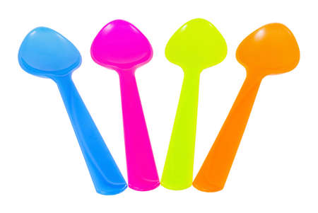 Color plastic tableware dishes , spoon on white background photo