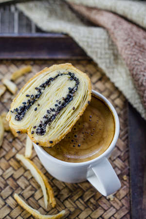 Cup of espresso coffee with Butterfly Pie photo