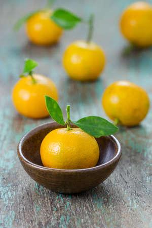 oranges (Citrus Japonica Thunb) in a ceramic dish photo