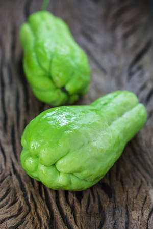 chayote: The chayote (Sechium edule) is a vegetable on wooden background