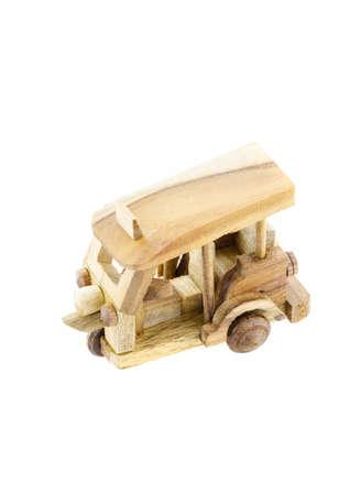 three wheel: Thailand three wheel native taxi (Tuk Tuk) wood model isolated on white background Stock Photo