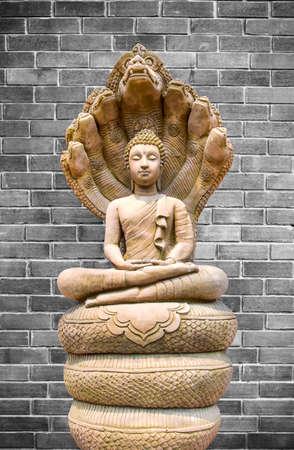 silently: Buddha image on old brick wall background