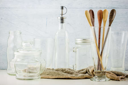 Collection of kitchenware on white wooden background photo
